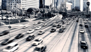 1600x900_highway-cars-city-traffic-buildings-black-white